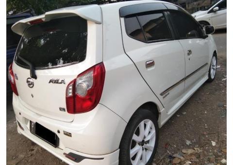 Daihatsu Ayla X elegant tahun 2014 akhir Putih Tgn1