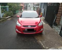 Hyundai Grand Avega GL 1.4L 2012 manual warna merah